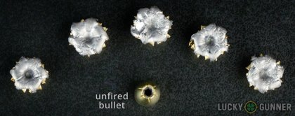 View from up above of fired Magtech 9mm Luger (9x19) bullets compared to an unfired round