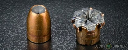 View from up above of fired SIG SAUER .40 S&W (Smith & Wesson) bullets compared to an unfired round