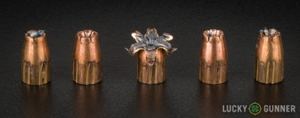 View from up above of fired Winchester 9mm Luger (9x19) bullets compared to an unfired round