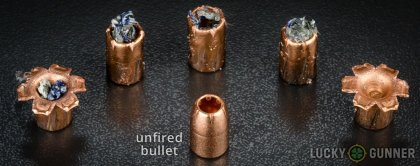 View from up above of fired Magtech .40 S&W (Smith & Wesson) bullets compared to an unfired round