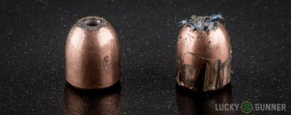 View from up above of fired Silver Bear 9mm Makarov (9x18mm) bullets compared to an unfired round