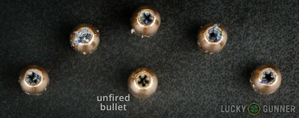 View from up above of fired PMC 9mm Luger (9x19) bullets compared to an unfired round