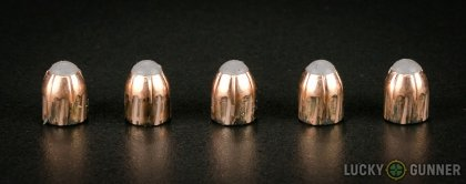 Side by side comparison of an unfired Corbon .380 Auto (ACP) bullet vs. the unfired round