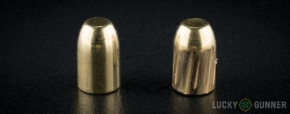 Side by side comparison of an unfired Buffalo Bore 10mm Auto bullet vs. the unfired round