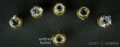 View from up above of fired Remington .45 ACP (Auto) bullets compared to an unfired round