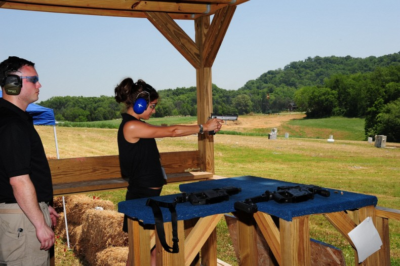 Kacie B shooting the Sphinx 3000 Competition pistol.
